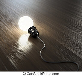 Light bulb - Glowing light bulb with black wire on wooden...
