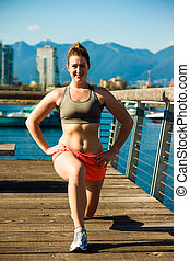 lunge at dockside - fitness girl lunge at dockside