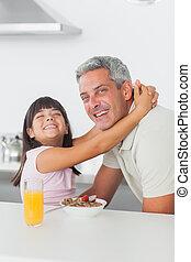 Smiling little girl hugging her dad