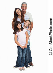 Portrait of a smiling family in single file on white...