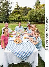 Happy extended family having dinner
