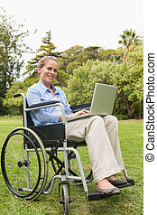 Smiling young woman in a wheelchair