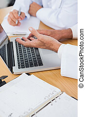 Close up on interrogative doctors hands in bright office
