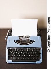 Old fashioned typewriter - Still life of blank sheet of...