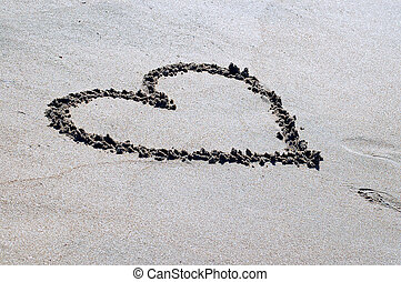 Drawed heart on the beach sand