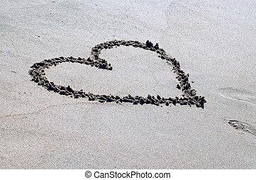 Drawed heart on the beach sand