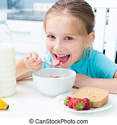 little girl eating - pretty little girl eating cereal and...