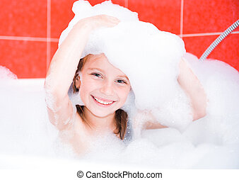 happy cute girl is taking a bath - Small pretty girl is...