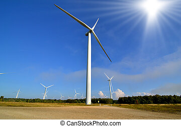 Windmills - Wind turbine park against the blue sky and...