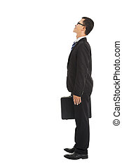 full length businessman standing and looking