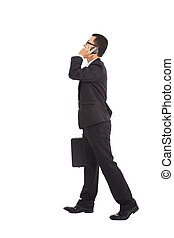 business man walking and talking on the phone