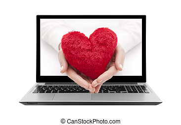 Laptop with red heart in hands