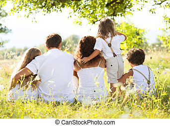 Happy family - Happy young family spending time outdoor on a...