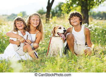 Happy kids with dog - Cute kids spending time outside with...