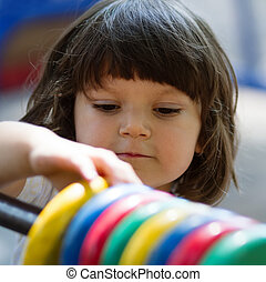 Little girl playing with count circles