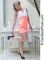 Pretty smiling girl posing in elegant pink dress - Pretty...