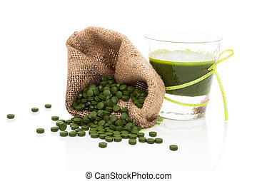 Detox. Green pills with green juice. - Green pills in brown...