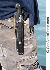 Survival knif - An hunting survival knife carry by a man on...