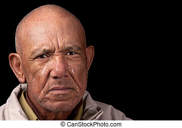 Crying old man - An old man cries whilst staring aimlessly.