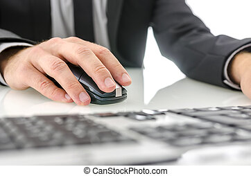 Closeup of using computer - Closeup of businessman using...