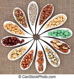 Nut Sampler - Nut selection in white porcelain dishes over...