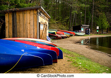 Canoes along the shore of Mazinaw Lake at Bon Echo...