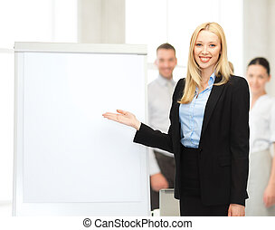 businesswoman with flipchart in office - bussiness, meeting...