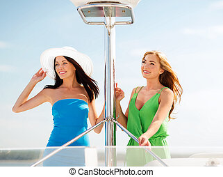 girls on boat or yacht - summer holidays and vacation...