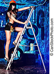 stepladder - Stunningly sexy girl posing with tools in the...