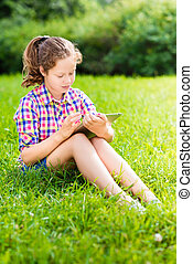 Teenager girl with digital tablet - Outdoor portrait of a...
