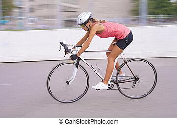 portrait of speedy biker woman in motion