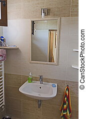 Wash-stand with mirror in bathroom in country house