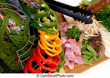 Wok with meat and vegetables - Wok cooking, cutting board...