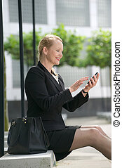 Business woman sending text message - Portrait of a business...