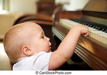 Cute baby playing on piano - Portrait of a cute baby playing...