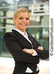 Beautiful business woman smiling outdoors