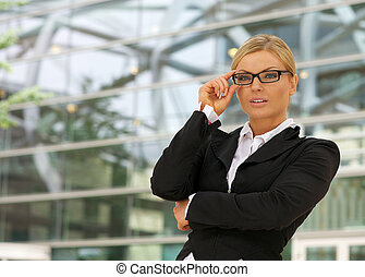 Portrait of a beautiful business woman in glasses