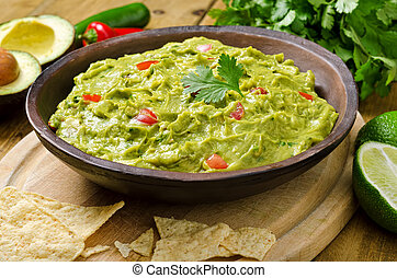 Guacamole Dip - Guacamole with avocado, lime, tomato, and...