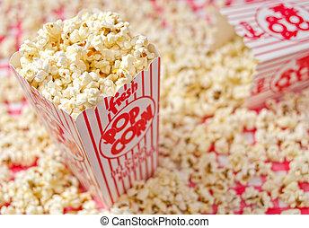 Popcorn - Freshly popped popcorn against a popcorn...