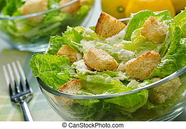 Caesar Salad - A bowl of crispy caesar salad with romaine...