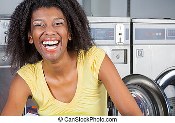 Cheerful Woman In Laundry