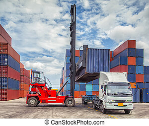 Crane lifter handling container box loading to truck