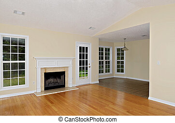 Living and Dining Area in House - Wood burning fireplace in...
