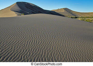 Sand dunes and ripples with a blue sky