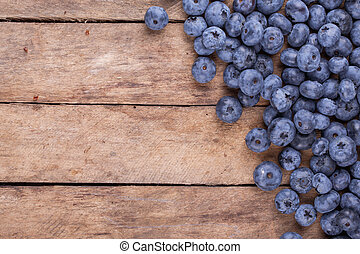 ripe blueberries on a wooden background