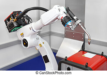 Robot welding - White robotic arm for welding in factory