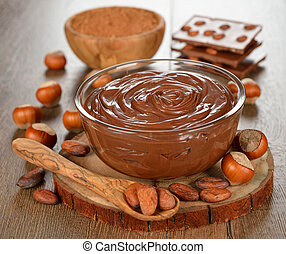 chocolate paste in a glass bowl on a brown table