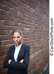 Offense - Image of angry businesswoman walking along brick...