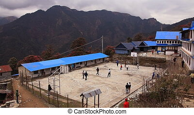 People play basketball in highlands Gorepani 2800 m in...