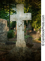 A lone marble cross at a cemetery